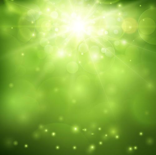 绿色星光闪烁背景图片